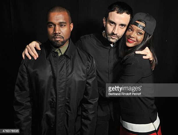 Kayne West Givenchy designer Riccardo Tisci and Rihanna attend the Givenchy show as part of the Paris Fashion Week Womenswear Fall/Winter 20142015 on...