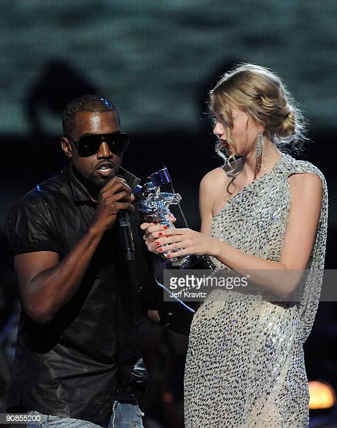 Kayne West jumps onstage as Taylor Swift accepts her award for the Best Female Video award during the 2009 MTV Video Music Awards at Radio City Music...