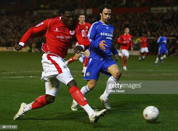 Kayode Odejayi of Barnsley crosses the ball ahead of Ricardo Carvalho of Chelsea during the FA Cup sponsored by E.ON 6th Round match between Barnsley...