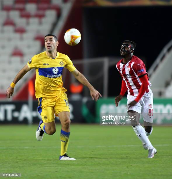 Kayode of Sivasspor in action against Tibi of Maccabi Tel-Aviv during UEFA Europa League Group I soccer match between Demir Grup Sivasspor and...