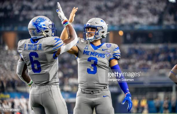 Kayode Oladele and Brady White of the Memphis Tigers reacts after scoring a touchdown during the Goodyear Cotton Bowl Classic at ATT Stadium on...