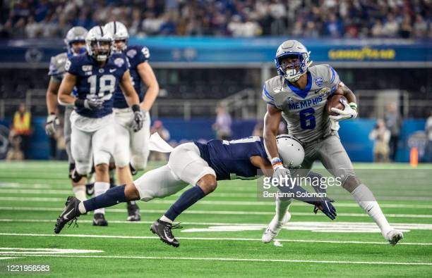 Kayode Oladele of the Memphis Tigers runs the ball during the Goodyear Cotton Bowl Classic at ATT Stadium on December 28 2019 in Arlington Texas