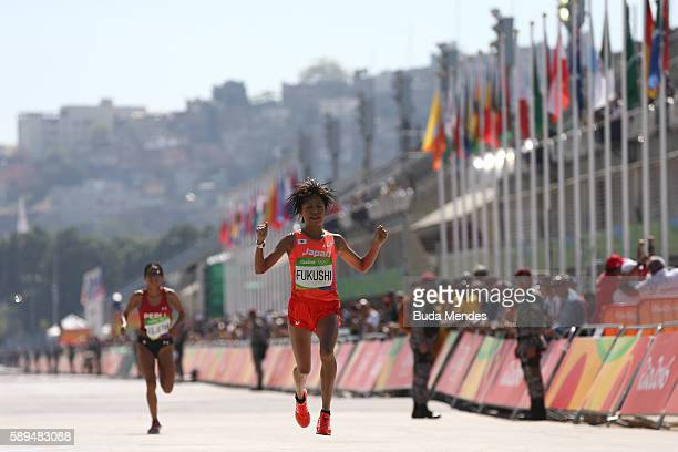 Kayoko Fukushi of Japan reacts as she crosses the finish line during the Women's Marathon on Day 9 of the Rio 2016 Olympic Games at the Sambodromo on...