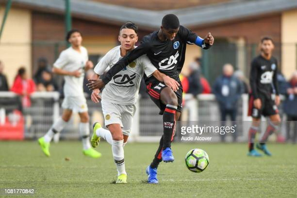 Kays Ruiz of Psg and Boubacar Coulibaly of Fleury during the Cup Gambardella match between Fleury and Paris Saint Germain on January 13 2019 in...