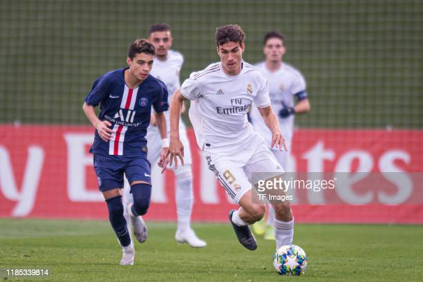 Kays RuizAtil of Paris SaintGermain and Pedro Ruiz of Real Madrid battle for the ball during the match between Real Madrid and Paris SaintGermain on...