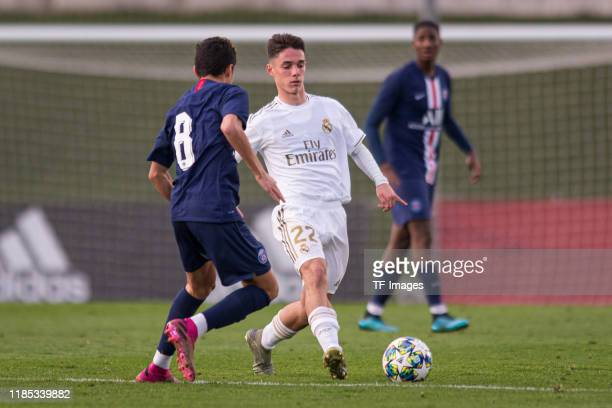Kays RuizAtil of Paris SaintGermain and Sergio Arribas of Real Madrid battle for the ball during the match between Real Madrid and Paris SaintGermain...