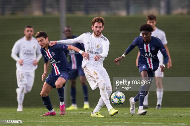 Kays RuizAtil of Paris SaintGermain Ismael Armenteros of Real Madrid and Maxen Kapo of Paris SaintGermain battle for the ball during the match...