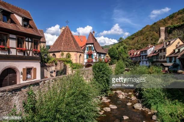 kaysersberg, alsace, france, europe - städtische straße stock pictures, royalty-free photos & images