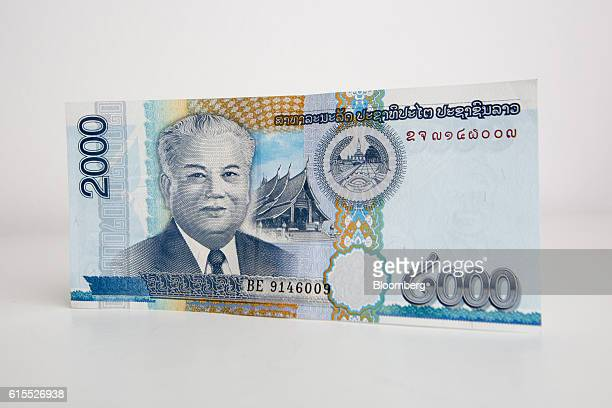 Kaysone Phomvihane former prime minister and president of Laos is featured on a Lao 2000 kip banknote in Bangkok Thailand on Tuesday Oct 18 2016...