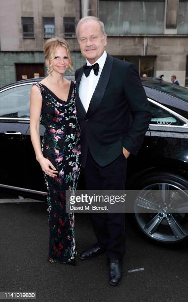 Kayte Walsh and Kelsey Grammer arrive in an Audi at the Olivier Awards 2019 at Royal Albert Hall on April 07 2019 in London England