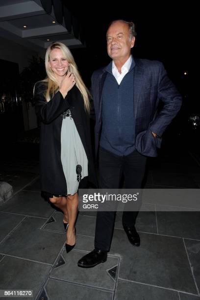 Kayte Walsh and Kelsey Grammer leaving Scotts restaurant Mayfair on October 20 2017 in London England