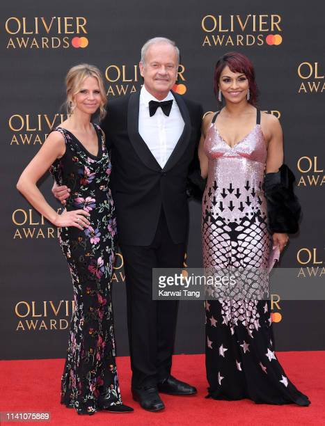 Kayte Walsh Kelsey Grammer and Danielle de Niese attend The Olivier Awards 2019 with MasterCard at Royal Albert Hall on April 07 2019 in London...