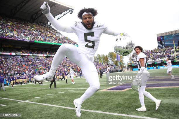 Kayvon Thibodeaux of the Oregon Ducks celebrates after defeating the Washington Huskies 35-31 during their game at Husky Stadium on October 19, 2019...