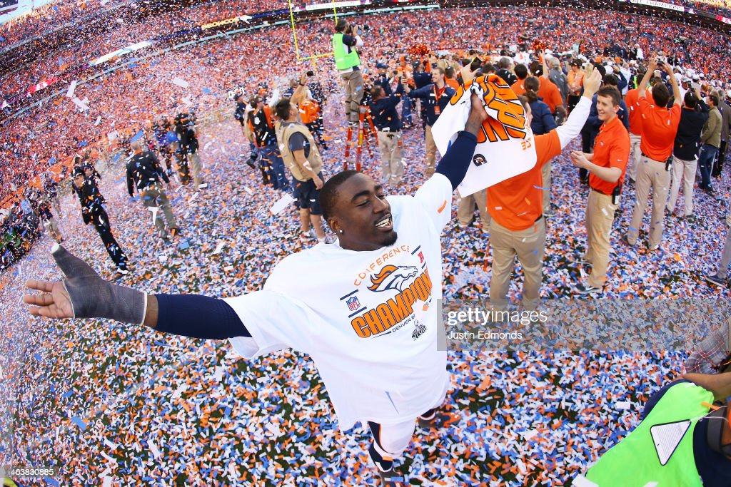 Kayvon Webster #36 of the Denver Broncos celebrates their 26 to 16 win over the New England Patriots during the AFC Championship game at Sports Authority Field at Mile High on January 19, 2014 in Denver, Colorado.