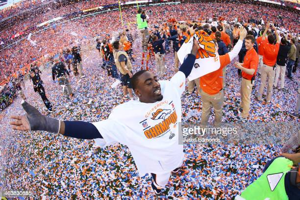 Kayvon Webster of the Denver Broncos celebrates their 26 to 16 win over the New England Patriots during the AFC Championship game at Sports Authority...