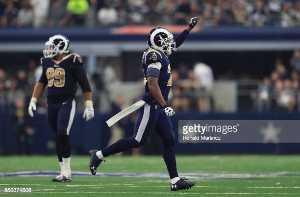 Kayvon Webster of the Los Angeles Rams celebrates after a turnover on downs by the Dallas Cowboys in the fourth quarter at ATT Stadium on October 1...