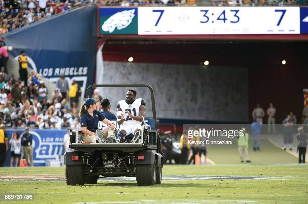 Kayvon Webster of the Los Angeles Rams is carted off the field after getting injured during the first quarter of the game against the Philadelphia...