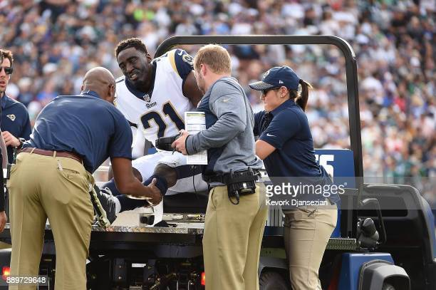 Kayvon Webster of the Los Angeles Rams leaves the game with an injury during the first quarter of the game against the Philadelphia Eagles at the Los...