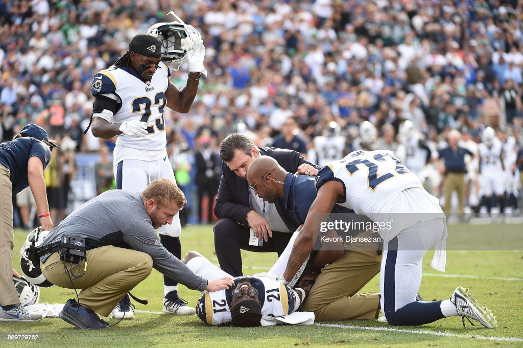 Kayvon Webster #21 of the Los Angeles Rams reacts after suffering an apparent injury during the first quarter of the game against the Philadelphia Eagles at the Los Angeles Memorial Coliseum on December 10, 2017 in Los Angeles, California.