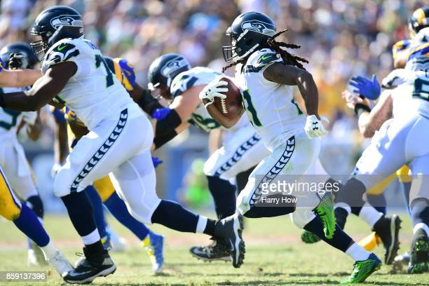 Kayvon Webster of the Los Angeles Rams runs the ball down field during the third quarter in the game against the Los Angeles Rams at Los Angeles...