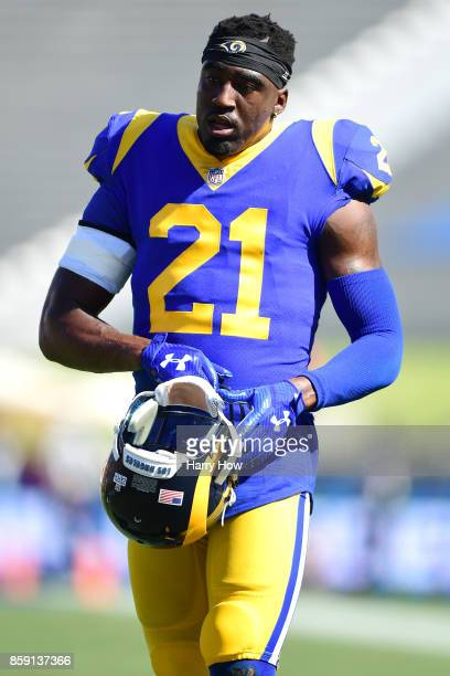 Kayvon Webster of the Los Angeles Rams walks on the field before the game against the Seattle Seahawks at the Los Angeles Memorial Coliseum on...