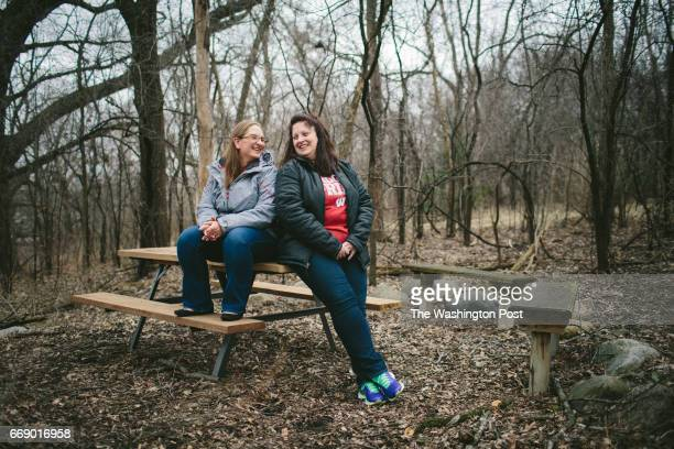 Kayzia Teal née Whitaker laughs with her mother Tammy Whiteaker while posing for portraits in Janesville After Teal's father was laid off from GM she...
