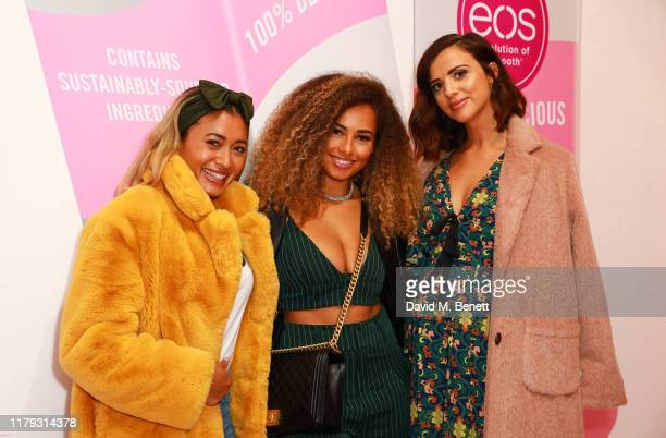 Kaz Crossley Amber Gill and Lucy Mecklenburgh attend the launch preview of eos lip balm popup the KeosK on November 1 2019 in London England The shop...