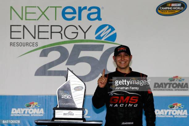 Kaz Grala driver of the KiklosGreekExtraVirginOliveOil Chevrolet celebrates in Victory Lane after winning the NASCAR Camping World Truck Series...
