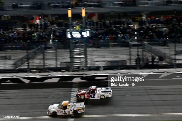 Kaz Grala driver of the KiklosGreekExtraVirginOliveOil Chevrolet crosses the finish line to win during the NASCAR Camping World Truck Series NextEra...