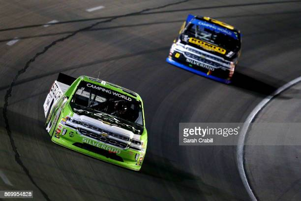 Kaz Grala driver of the Stealth Chevrolet leads John H Nemechek driver of the ROMCO Equipment/Fire Alarm Services Chevrolet during the NASCAR Camping...