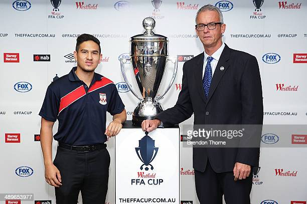 Kaz Patafta and FFA CEO, David Gallop pose with the Westfield FFA Cup during an FFA Cup Announcement at the FFA Offices on May 12, 2014 in Sydney,...