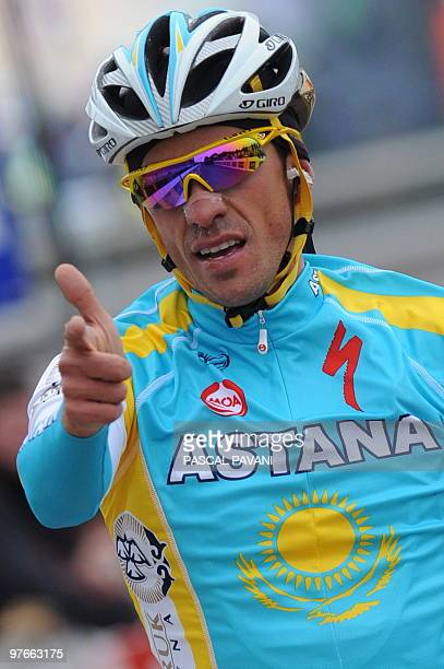 Kazahkstan's Astana cycling team's Spain's Alberto Contador celebrates on the finish line after winning on March 11, 2010 the 173,5 km fourth stage...