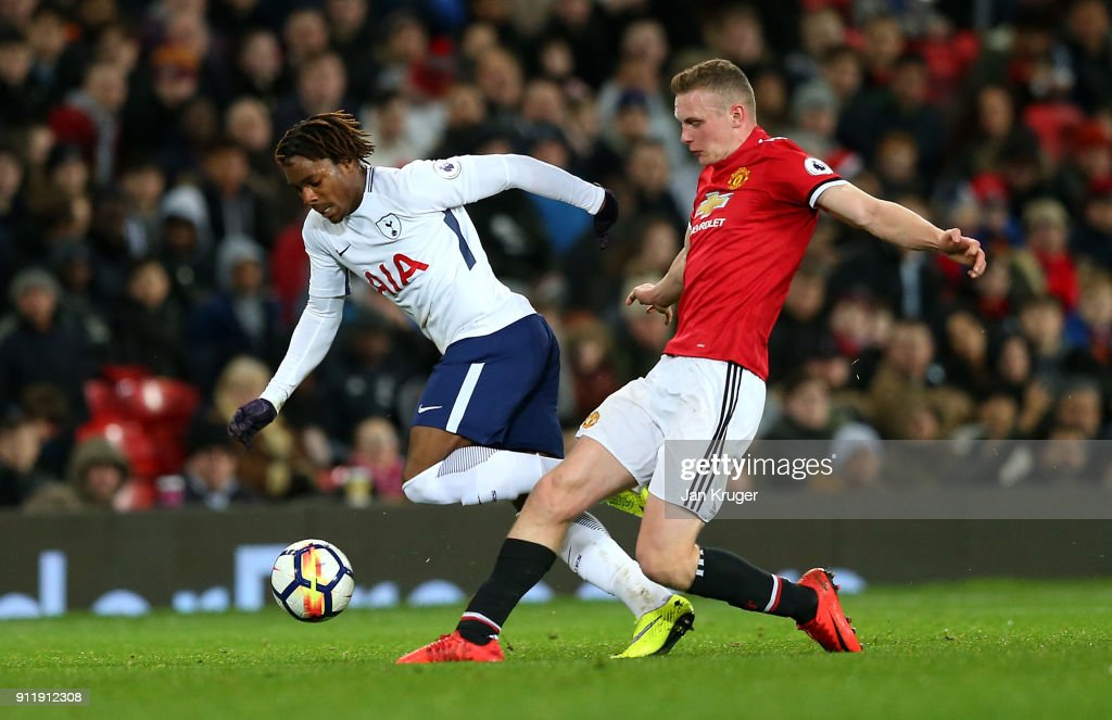 Kazaiah Sterling of Tottenham Hotspur battles with Ethan Hamilton of Manchester United during the Premier League 2 match between Manchester United and Tottenham Hotspur at Old Trafford on January 29, 2018 in Manchester, England.