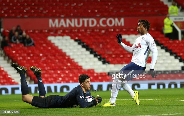 Kazaiah Sterling of Tottenham Hotspur has his penalty and follow up saved by Joel Pereira of Manchester United during the Premier League 2 match...