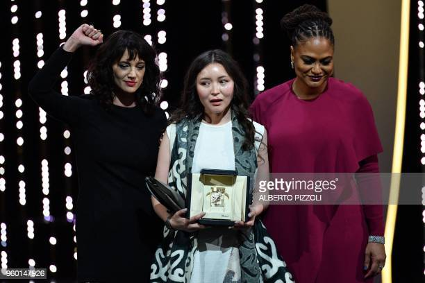 TOPSHOT Kazakh actress Samal Yeslyamova poses on the stage with Italian actress Asia Argento and US director and screenwriter and member of the...