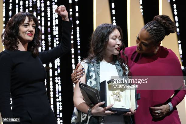 Kazakh actress Samal Yeslyamova poses on the stage with Italian actress Asia Argento and US director and screenwriter and member of the Feature Film...