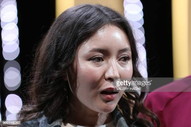 Kazakh actress Samal Yeslyamova reacts after she was awarded with the Best Actress Prize for her part in 'Ayka ' on May 19 2018 during the closing...