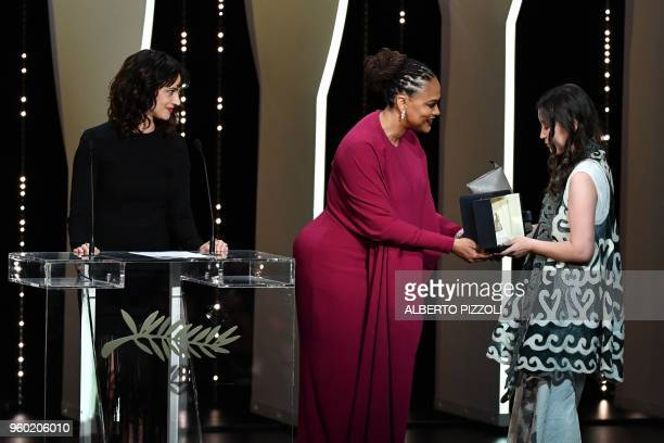Kazakh actress Samal Yeslyamova receives her trophy from US director and screenwriter and member of the Feature Film Jury Ava DuVernay next to...