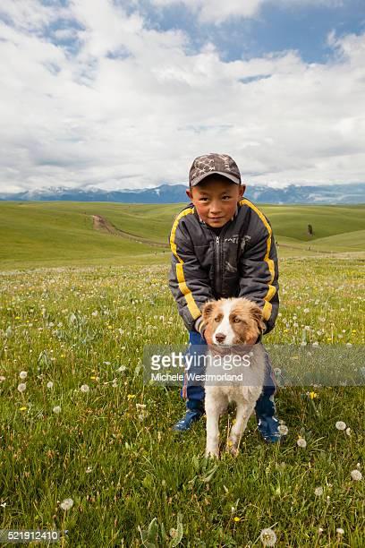 Kazakh Boy with Puppy