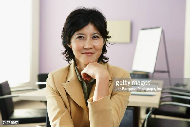Kazakh businesswoman in conference room
