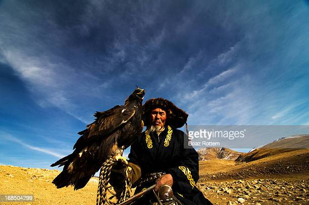 Kazakh eagle hunter on his horse. This form of hunting is an old tradition and is common in Central Asia. Photo taken in western Mongolia.