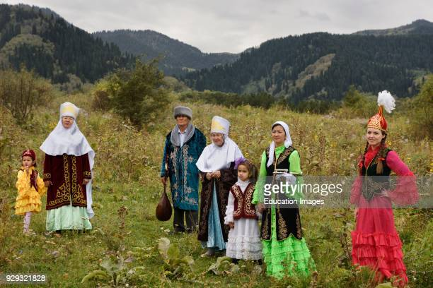 Kazakh family in traditional clothes after Tusau Kesu ceremony in field at Huns Village Kazakhstan