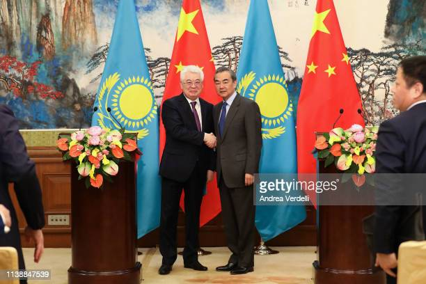 Kazakh Foreign Minister Beibut Atamkulov and Chinese Foreign Minister Wang Yi shake hands at the end of the press conference at Diaoyutai State...
