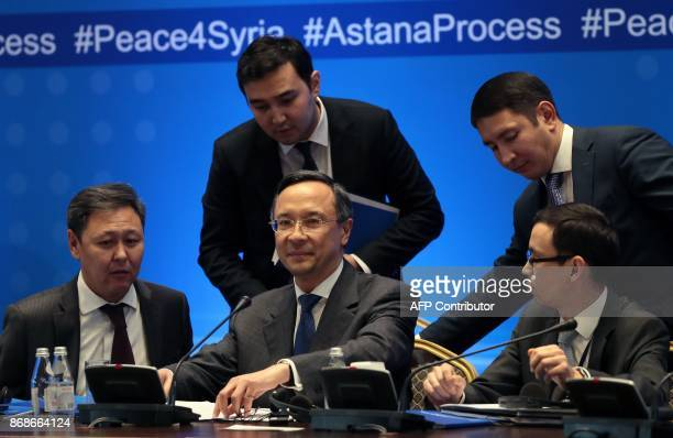 Kazakh Foreign Minister Kairat Abdrakhmanov along with other attendees take part in the session of Syria peace talks in Astana on October 31 2017...
