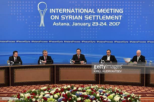 Kazakh Foreign Minister Kairat Abdrakhmanov reads a final statement on Syria peace talks as UN envoy for Syria Staffan de Mistura looks through his...