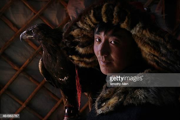 Kazakh golden eagle hunter & eagle in ger