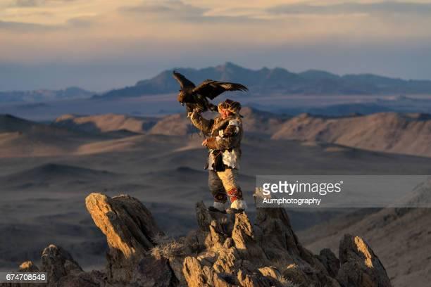 Kazakh golden eagle hunter on Altai mountains, Mongolia