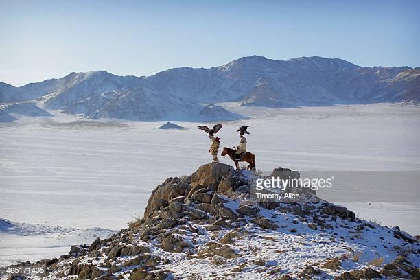 kazakh golden eagle hunters fly eagles - モンゴル ストックフォトと画像
