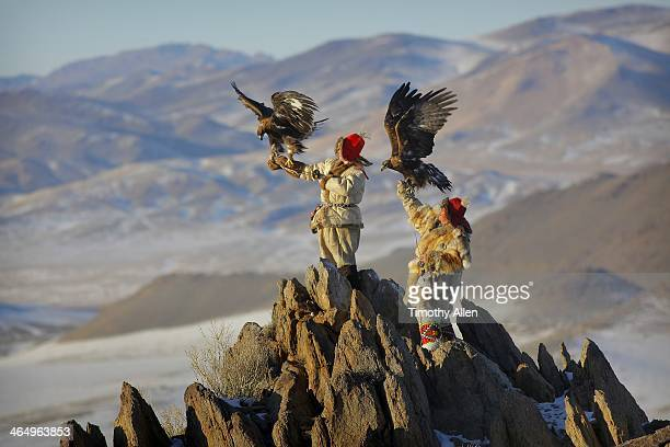 kazakh golden eagle hunters in altai mountains - モンゴル ストックフォトと画像