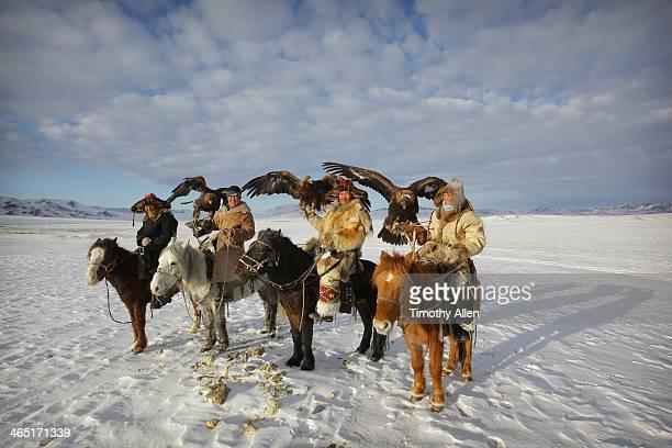 Kazakh golden eagle hunters on horseback